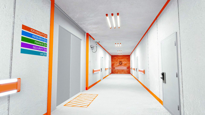 They may not look like much, but those orange bars placed along the walls instinctively tell us where to go. Similar rectangles of paint are often use in hospitals to guide people.
